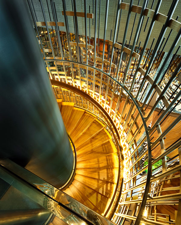 PARKROYAL on Pickering by WOHA - View of spiral stairs connecting ground floor and 2nd floor