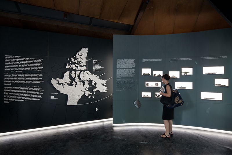 View of Corian Nunavut map, marking all 25 communities and carvings by Inuit artists, describing architecture's legacy in the territory over the past 100 years, Arctic Adaptations, 2014