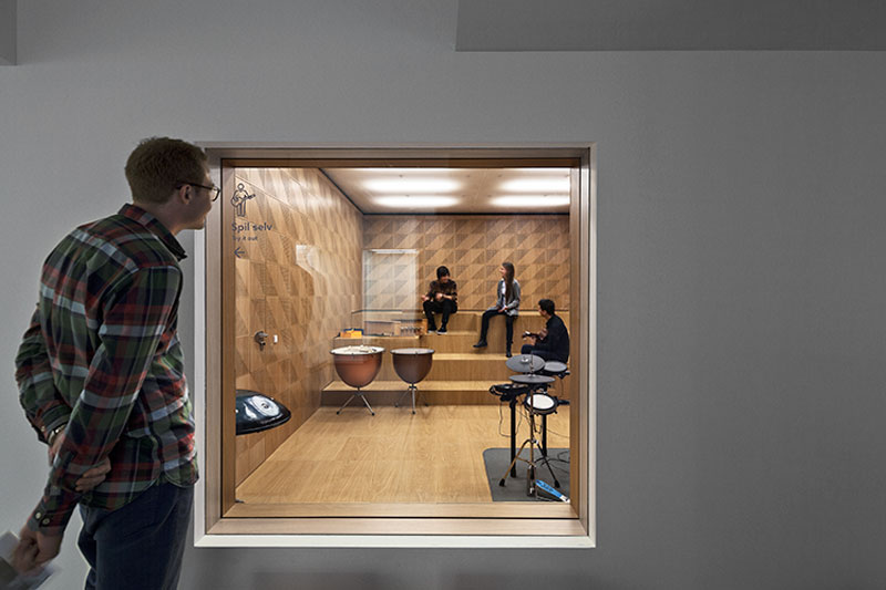 Spatial layers showcasing window for visitors to watch performances - Sonorous Museum by ADEPT