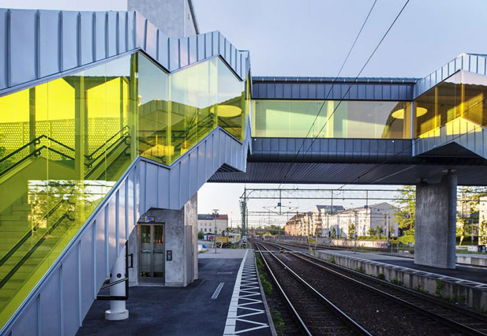 Colourful pedestrian bridge in Sweden by Metro Arkitekter