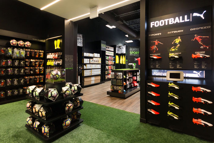 In2Sports Retail Store - Unfold Creative Studio - 1- Boot Area looking out at the front of the store