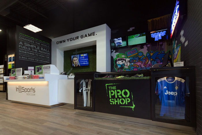 In2Sports Retail Store by Unfold Creative Studio - Front Cash and Pro Shop Area for customization of soccer gear