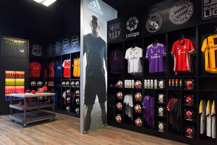 In2Sports Retail Store by Unfold Creative Studio - Fan Wear Area organized by team to make it easier for fans
