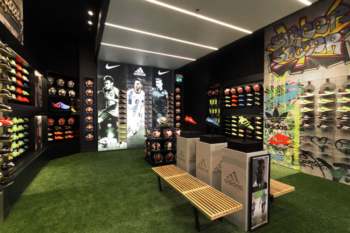 In2Sports Retail Store by Unfold Creative Studio - The Boot Room was designed to for ease of shopping based on consumer habits. The large scale custom graffiti was introduced to represent and showcase street soccer.